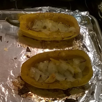 Delicata squash stuffed with onions, garlic, and herbs. Covered with maple syrup.